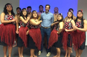 Eric Bruns with Maori high schoolers performing haka dance